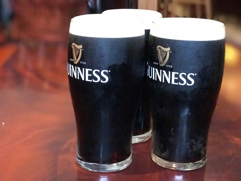 Three frosty imperial pints of Guinness Extra Stout